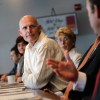 Gov. Rick Scott listens at a Miami business roundtable meeting in August.