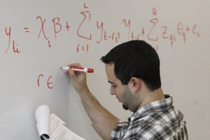 Miami-Dade high school advanced calculus teacher Orlando Sarduy writes out the formula that will grade and help determine the pay of Florida teachers.
