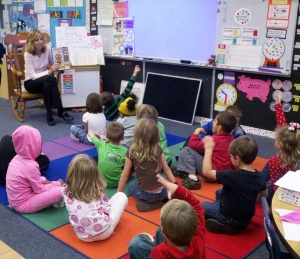 Mrs. Kenton and her kindergarten students discuss a story about a gingerbread man. The students must be able to show they comprehend what they're reading.
