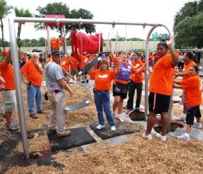 Volunteers build a playground at Community Charter School of Excellence in Tampa.