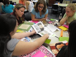 University of Central Florida elementary education students discuss how to incorporate books, maps, magazines and other materials into lesson plans. The program earned strong marks in a new national ranking.
