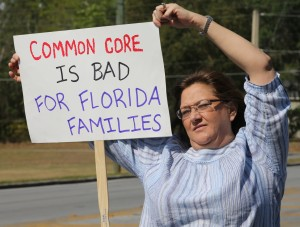 P.G. Schafer, a Tea Party member, holds a sign to protest Common Core across the street from Marion Technical Institute where school administrators were meeting on Southeast Fort King Street in Ocala, Fla. on Wednesday, April 3, 2013.