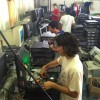 Students at Palm Vista Community High School refurbish computers for donation.