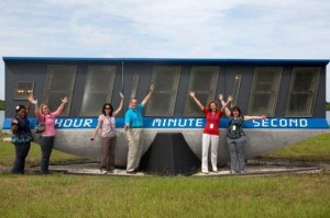 Lockheed Martin-NSTA 2012-2013 Fellows--Lauren Case, Valerie Christou, Mary Maddox, Stephen Kirsche, Robin Barkes and                                 Robin Hockey--at the NASA Press Site countdown clock.