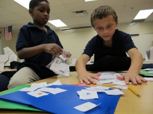 Second graders at Christel House Academy, a charter school in Indianapolis, play fraction games.