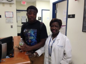 Nicholas Boothe (left) had an asthma attack last winter and Dr. Marcia Dodo (right) helped stabilize him at the North Miami Beach Senior High clinic.