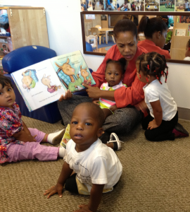 Every morning, children at Education Station begin the day with a hug and a book.