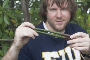 Nicholas Ogle will replant the mangrove propagules collected by MAST students.