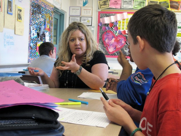 Monroe Middle School teacher Dawn Norris talks to her students about how to write an essay about fairy tales. Norris has been teaching based on the Common Core standards for two years. Since making the switch, she says her students have taken more control of the lessons.