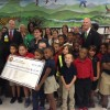 Gov. Rick Scott presented Hillsborough schools with an $8.5 million check. Schools which earned an A on the state report card or significantly improved their grade earned a $100 bonus per student.