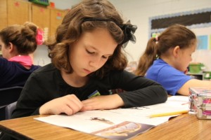 A student in Casi Adkinson's third grade class reads a non-fiction passage. Adkinson said that although the emphasis this year is on evidence-based writing, she still  encourages students to add creativity to their writing.