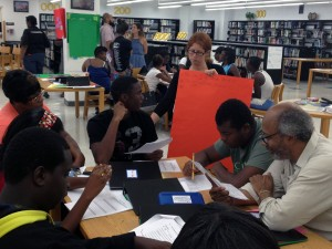 Sara Weinberg talks Miami Northwestern High School students through an Algebra Project assignment.