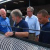 Gov. Rick Scott and former Gov. Jeb Bush tour a Homestead manufacturing facility in August.