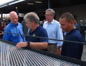 Gov. Rick Scott and former Gov. Jeb Bush tour a Homestead manufacturing facility earlier this month. Scott want to review Florida's academic standards and local testing.