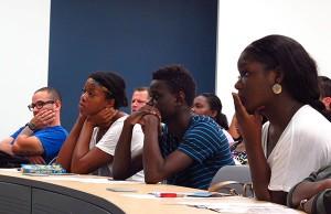 Broward College student listen to Kent Dunston's debt management workshop.