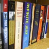 """Some of the books in Daniel Dickey's library. No student has tackled """"Infinite Jest"""" yet, considered one of the longest and most complicated American novels."""