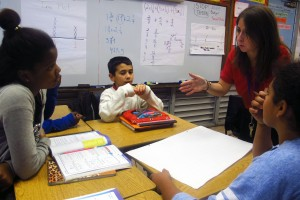 Frances S. Tucker Elementary Schoo fifth grade math teacher Yaliesperanza Salazar leads her class through an exercise to group data on a line graph.