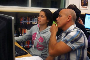 Manuela Castano and her father, Edian, work on the FAFSA.