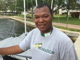 Quan Jones of Project 10 Stingray works at the marina behind USFSP