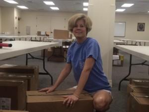 Lizbeth Engle packs boxes of clothing
