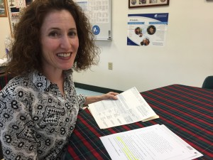 Miami teacher Brigette Kinney qualifies for a new state bonus program, but may not be able to compete the paperwork in time.