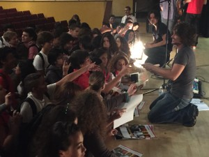 Members of the band GOODING answer questions and sign posters for Miami Beach High students.