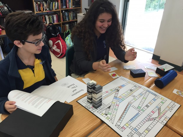 "Ada Merritt K-8 Center 8th graders Theo Urquiza and Victoria Fernandez play a role-playing game based on the book ""Everlost"" that their classmates created."