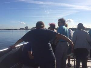Maritime Academy Director John Paradis (c) on the Port tour