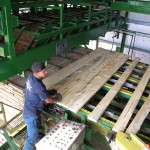 Worker stacks boards at the Emerald Forest Products mill in Emmett, Idaho.
