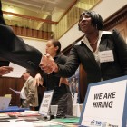 Job seekers met with recruiters at a California job fair this summer.