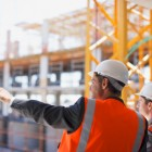 Construction workers surveying a job site