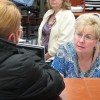 Sandy Brown helps a client with paperwork for food stamps benefits in the Boise office.
