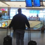 A passenger surveys arrivals and departures.