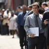 Workers lined up at a job fair in June.
