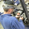 In Meridian, a worker trains to become a mechanical technician.