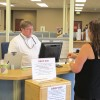 A Department of Labor employee assists a jobless client at a state office in Meridian.