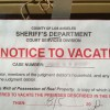 An eviction notice hung in the window of a home Glendale, California last month.