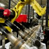 A robotic arm picks up prop shafts during final inspection at the Mennie Machine Co. in Mark, Illinois.