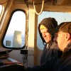 Ed Eastman (L) and Jim Pasnar (R) study a map to determine where they will drop the net for a three-mile trawl.