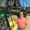 Steve Conrad, owner of Conrad Farms, shows off the tractor he converted to pick spinach.