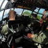 Capt. Steven Martina of the 36th Airlift Squadron communicates to the flight crew of a C-130.