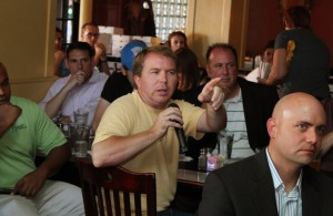 Audience members ask lawmakers questions during a Policy and a Pint event in July.