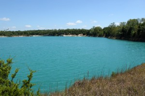 After this quarry near a U.S. Silica sand mining operation was mined out, clear blue aquifer water filled it in.