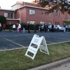 Voters line up to cast ballots shortly after precincts opened in Oklahoma City.