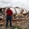 Tim Marshall, a metrologist and civil engineer, stands near a water tank in a tornado-ravaged Moore neighborhood. The tank fell from the sky after being carried a half-mile, Marshall says.