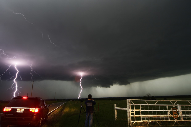 Cloud to ground lightning strikes near storm chasers during a tornado thunderstorm in Cushing, Okla., on May 31.