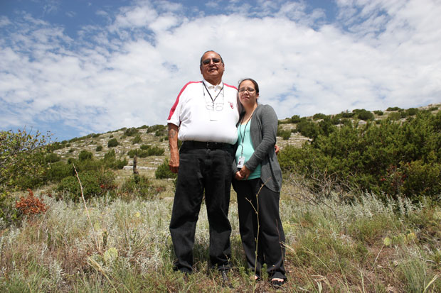"Kiowa historian Phil ""Joe Fish"" DuPoint and Kiowa museum director Amie Tah-Bone stand at the base of Longhorn Mountain, near Coopertown, Okla. DuPoint and Tah-Bone say a new limestone mine will desecrate the mountain, which the tribe considers a sacred site and source of ceremonial cedar."