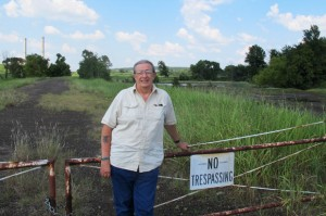 Grand Riverkeeper Earl Hatley stands at the edge of the GRDA power plant's property near Chouteau, Okla.