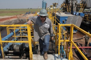 Toolpusher and rig manager Darrin Silcot walks the perimeter of a Triad Energy horizontal drilling operation near Alva, Okla.