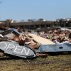 An 'open' sign is one of the few items left after a tornado struck this convenient store in Moore, Okla.